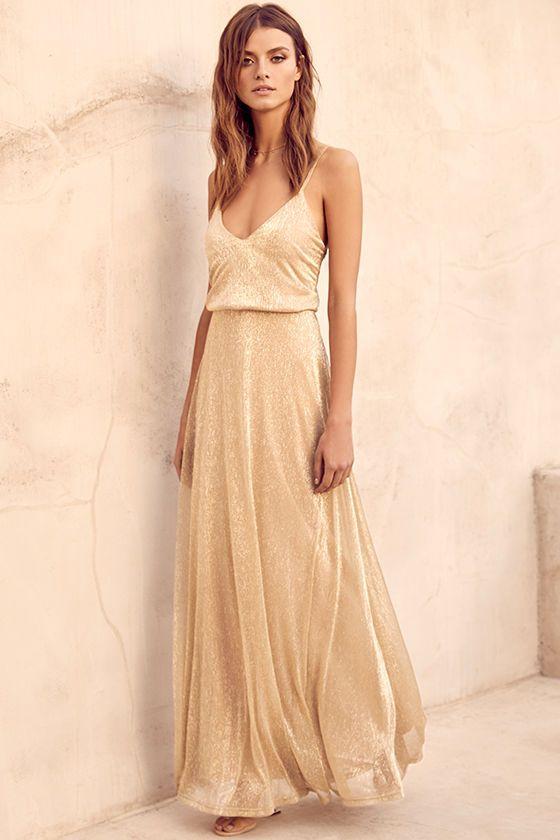 Guld mousserande klänning triangel