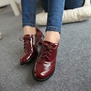 Mörkblå skinny jeans med bruna lädervingtip oxfords