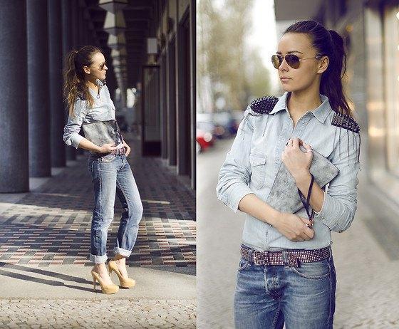 ljusgrå skjorta med knappar och baggy jeans med bälte