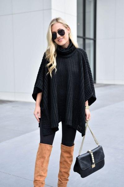 svart turtleneck-tröja med kabelmönster och kamel överknee stövlar