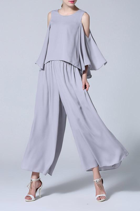 grå kall axelblus vädjade för byxor med breda ben
