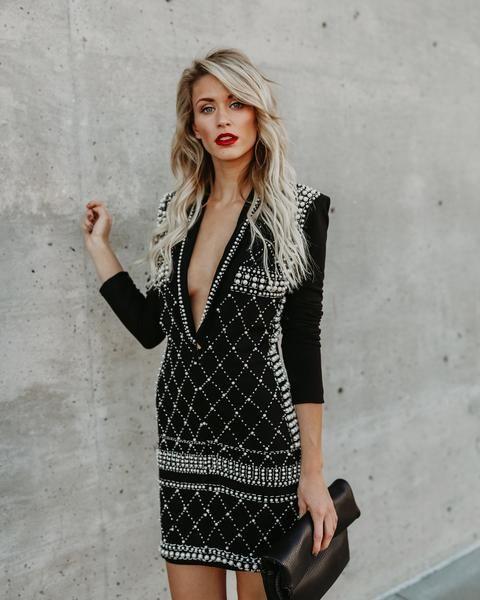 svarta glittrande klädpärlor