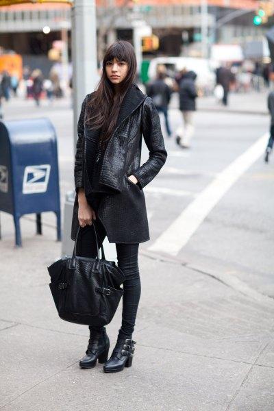 lång skinnjacka svarta skinny jeans ankel stövlar