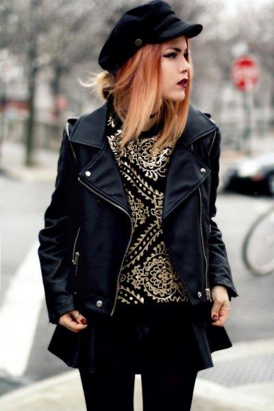 svart skinnjacka med minirater kjol och leggings