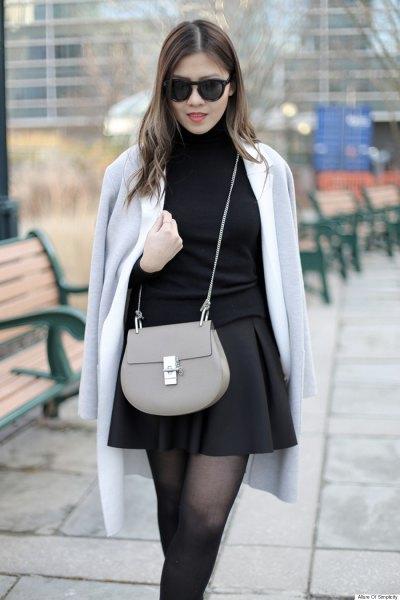 grå ullrock över axeln svart skater kjol