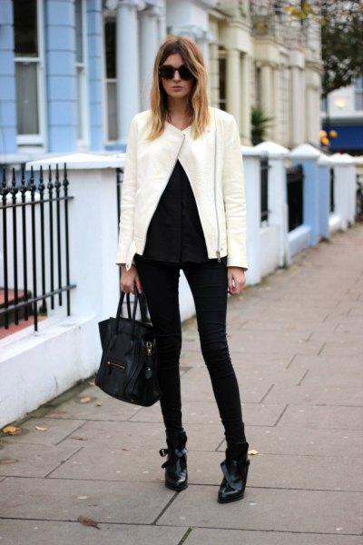 vit jacka helt svart outfit