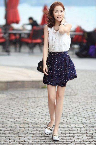 ärmlös skjorta i vit chiffon svart skridsko kjol i chiffon