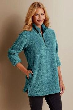 Tunika fleece tröja med halv dragkedja och svarta jeans