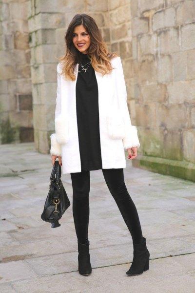 vit ullrock svart tröja klänning