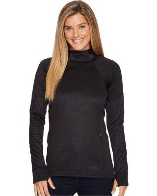 svart långärmad tröja med mock hals och matchande jeans