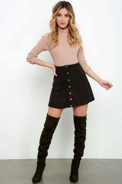 rosa ribbstickad tröja med svart corduroy kjol