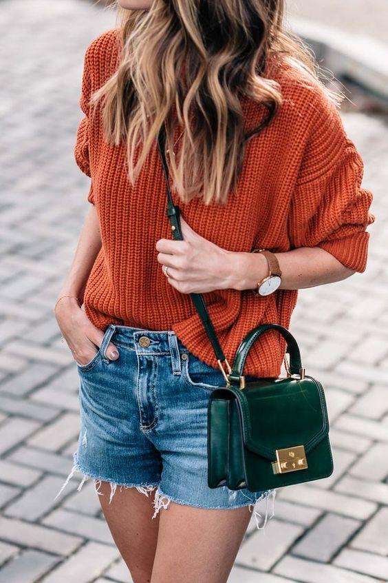 grön ficka av bränd orange tröja