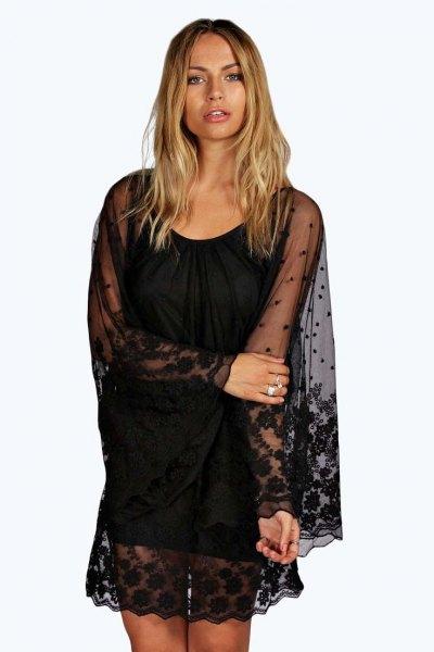svart slida klänning spets halvtransparent