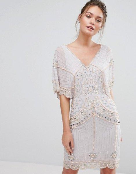 vit bat min klänning guld paljetter detaljer