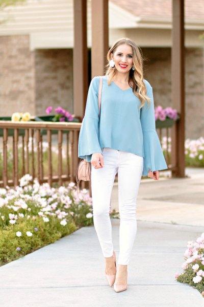 Tiffany blå flare ärm blus vita jeans
