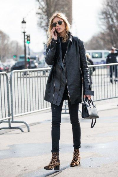 svart överdimensionerad skinnjacka skinny jeans
