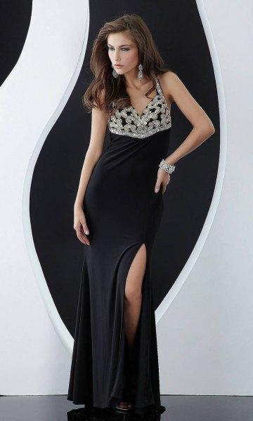 silver och svart, tvåfärgad paljettklänning med djup V-ringning och slits