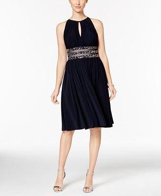 svart knälång klänning silver paljett bälte