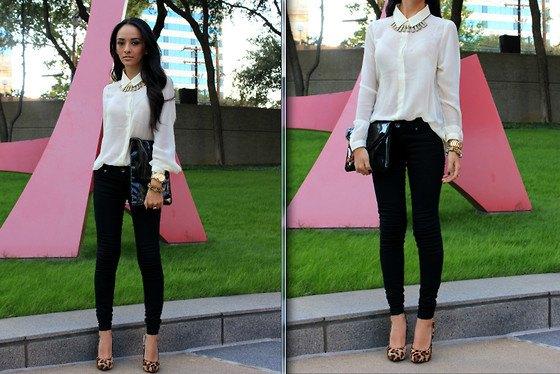 vit skjorta med knappar och svarta skinny jeans och klackar med leopardmönster