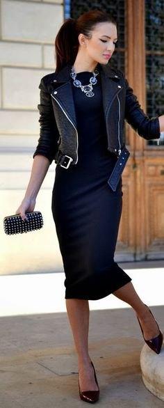 svart skinnjacka med midiklänning och klackar