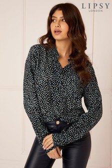 svart och silver, glittrande skjorta med paljetter och läderjackor