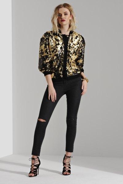 guld och svart bomberjacka rippade smala jeans