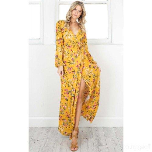 Senapsgul, hög split, lång omlottklänning med blommönster