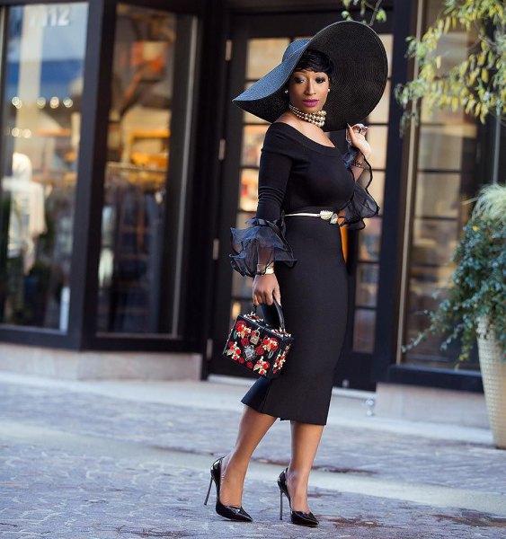 svart kyrkodräkt med stor diskett hatt