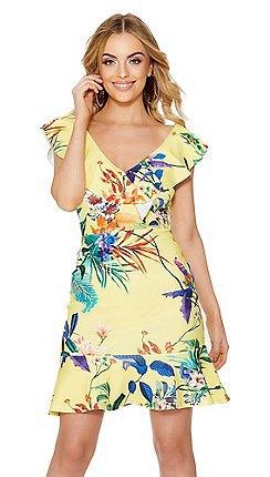 ljusgul klänning med rufsade ärmar och V-ringning och blommönster