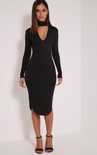 svart långärmad krage med djup V-ringning och figur-kramad klänning