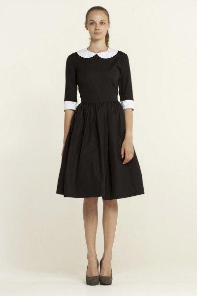 svart, halvärmad, utsvängd miniklänning med rund krage
