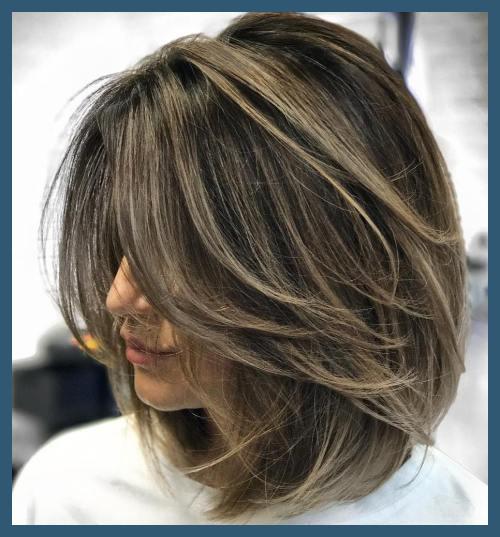 Axel längd lager hårklippningar 67963 70 Ljusaste medellånga.