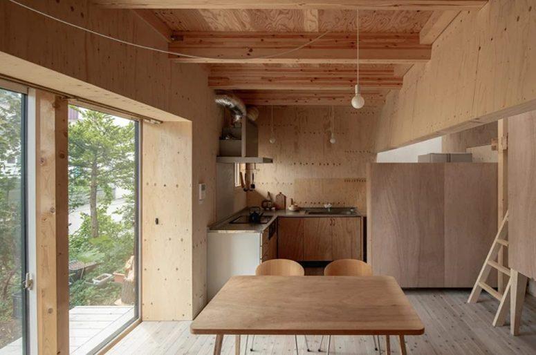 Minimalistisk Sapporo-bostad med en krökt vit vägg - DigsDi