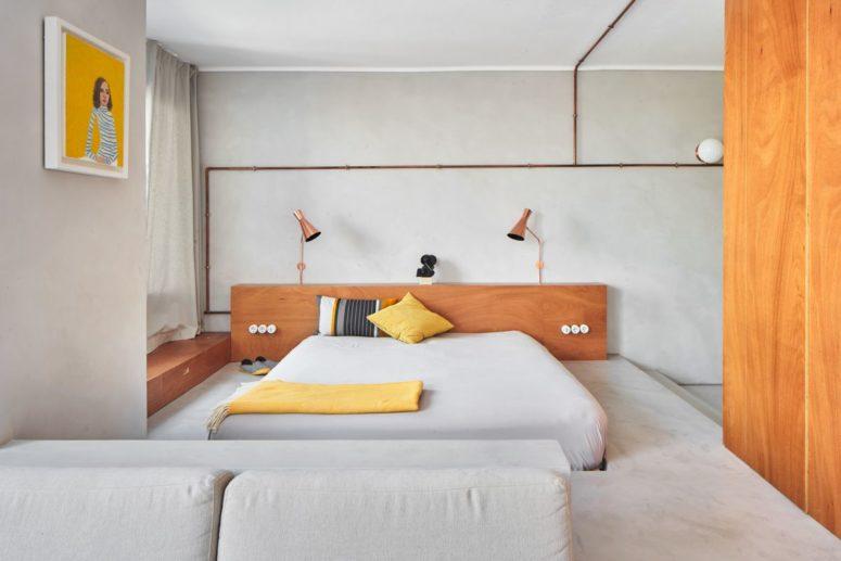 Minimalistisk lägenhet gjord med betong- och kopparrör - DigsDi