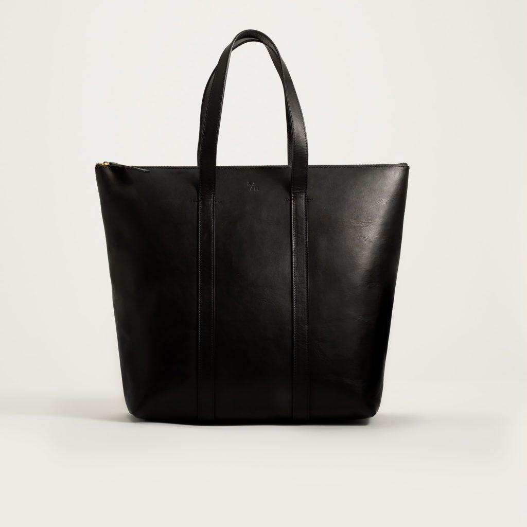 Hur man bär svart läderväska