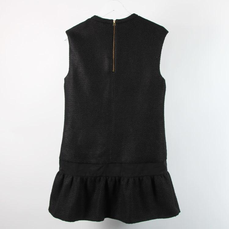 Hur man utformar svart korsettklänning
