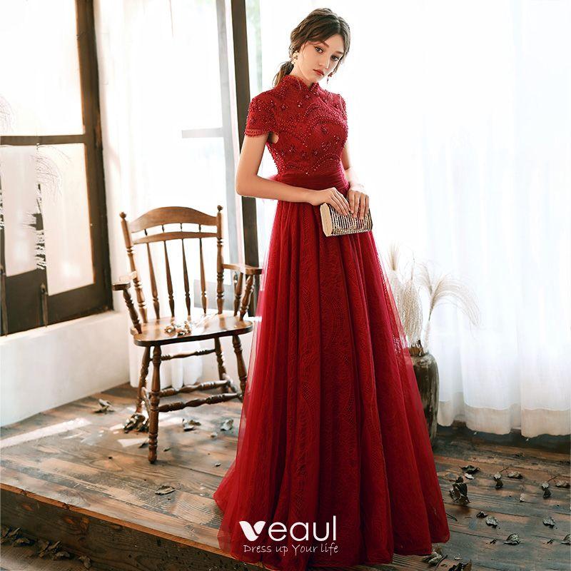 Korta långa röda paljettkläder