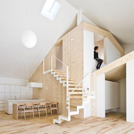 Minimalistisk Sapporo-bostad med en krökt vit vägg