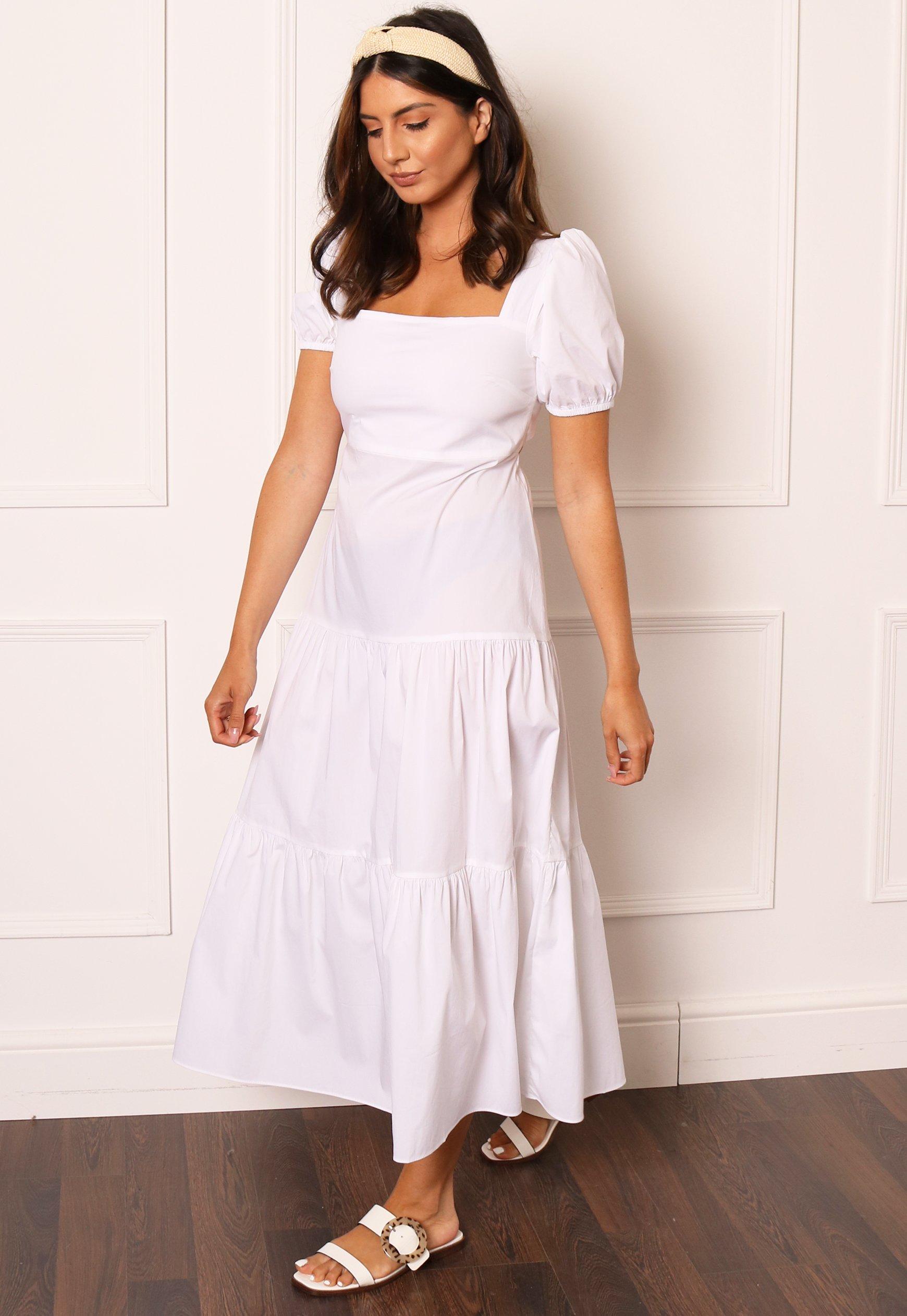Stil vit utklädd klänning